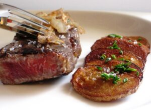 Steak Potato Slices 300x219 Meat and Potatoes with Bordeaux Wine Makes a Perfect Match!
